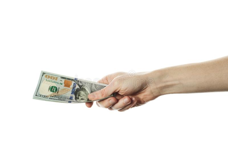 Man hand giving 100 dollar bills isolated on white background. Modern American US dollar note.  royalty free stock image