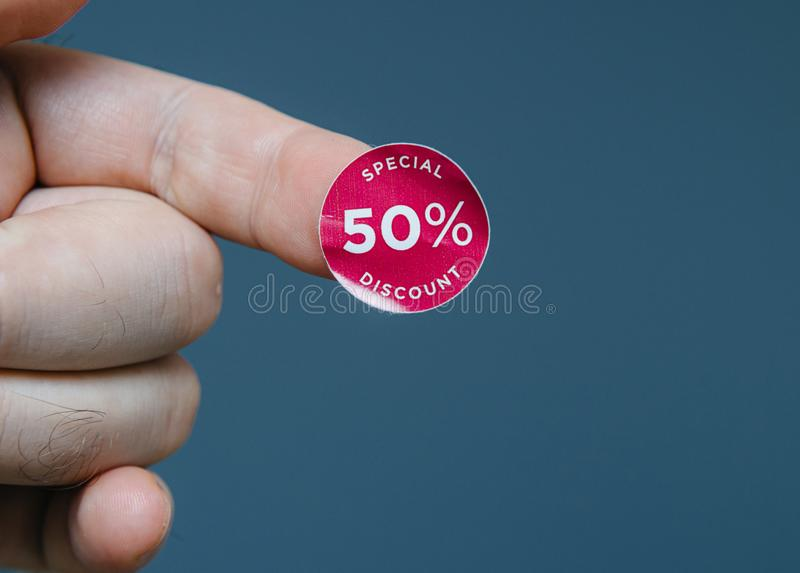 Man hand with glue sticked discount sale special price. Man hand with glue sticked discount sale special 50 percent off price price red tags to be glued on goods stock photo