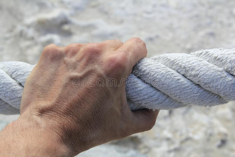 Man hand grab grip strong big aged rope royalty free stock photos