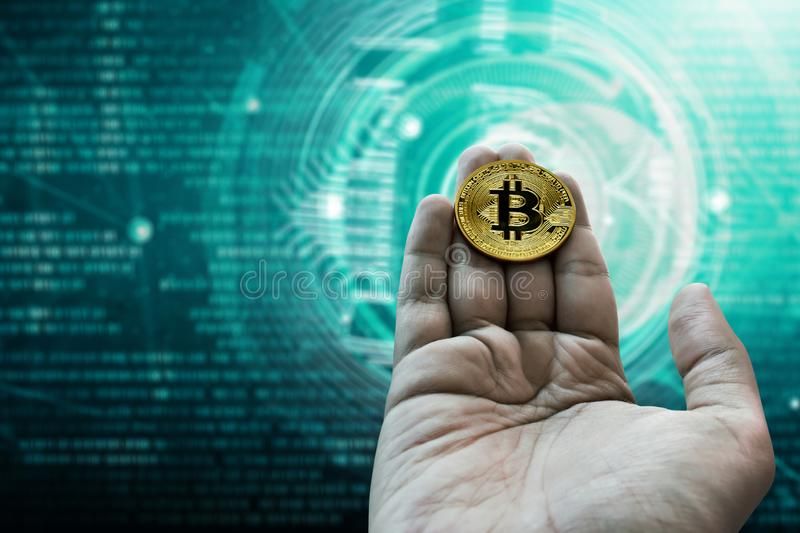 Man hand hold golden bitcoin. Man hand holding golden bitcoin royalty free stock images