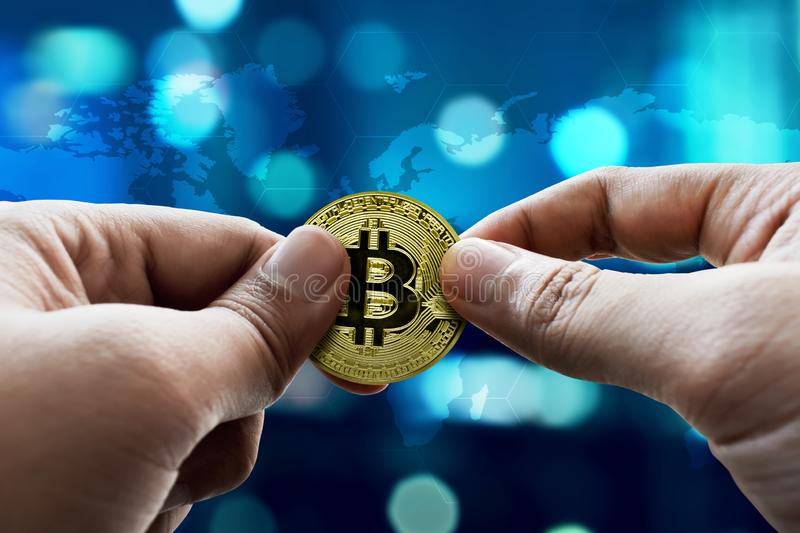 Man hand hold golden bitcoin. Man hand holding golden bitcoin stock photo
