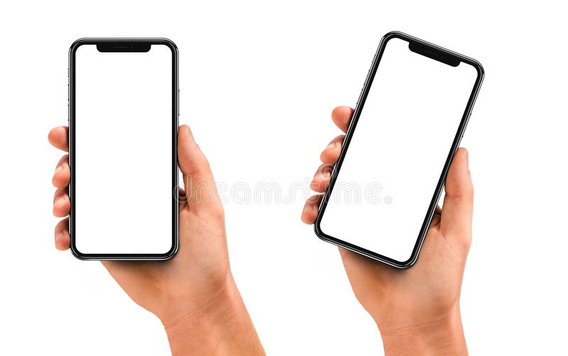 Man hand holding the black smartphone with blank screen. And modern frame less design - isolated on white background royalty free stock photography