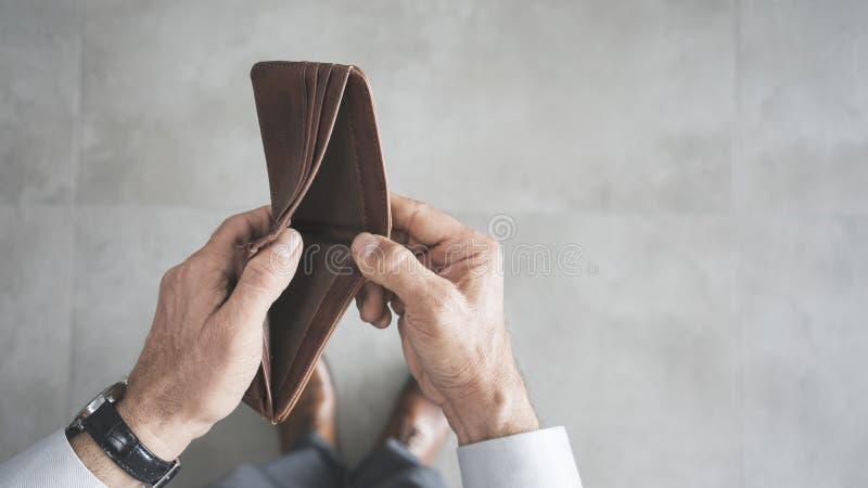 Man hand holding empty wallet stock photos