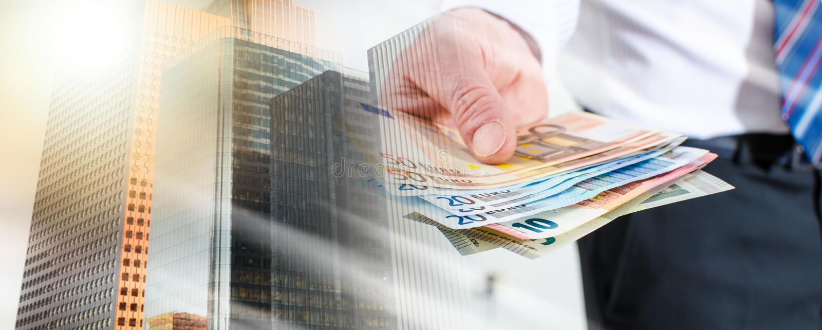 Man hand holding euro notes; multiple exposure stock photography