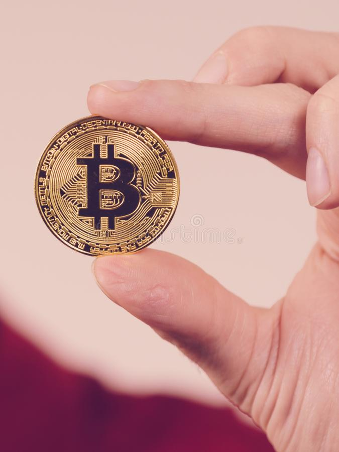 Man hand holding golden bitcoin royalty free stock photo