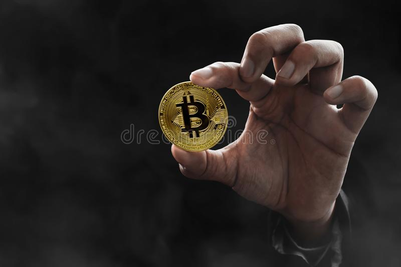 Man hand holding golden bitcoin. Man hand hold golden bitcoin royalty free stock photos