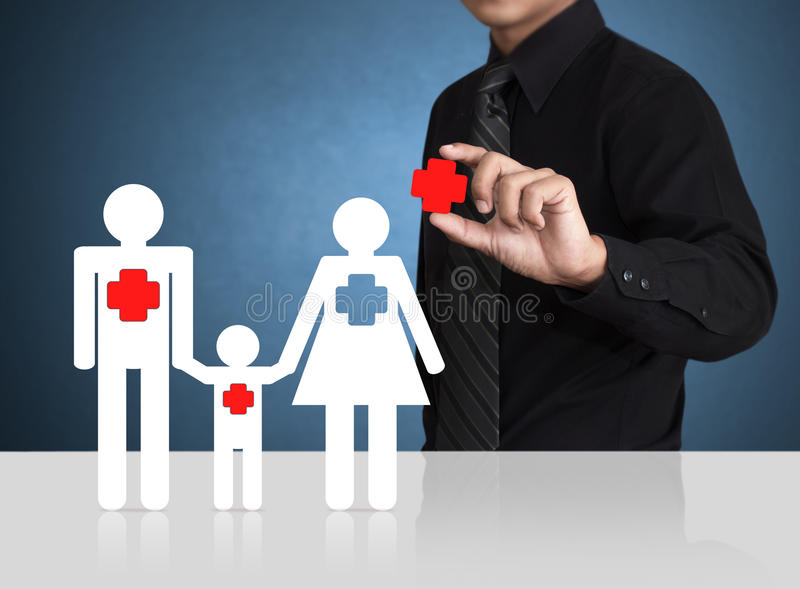Man hand holding insurance symbol with paper family stock images