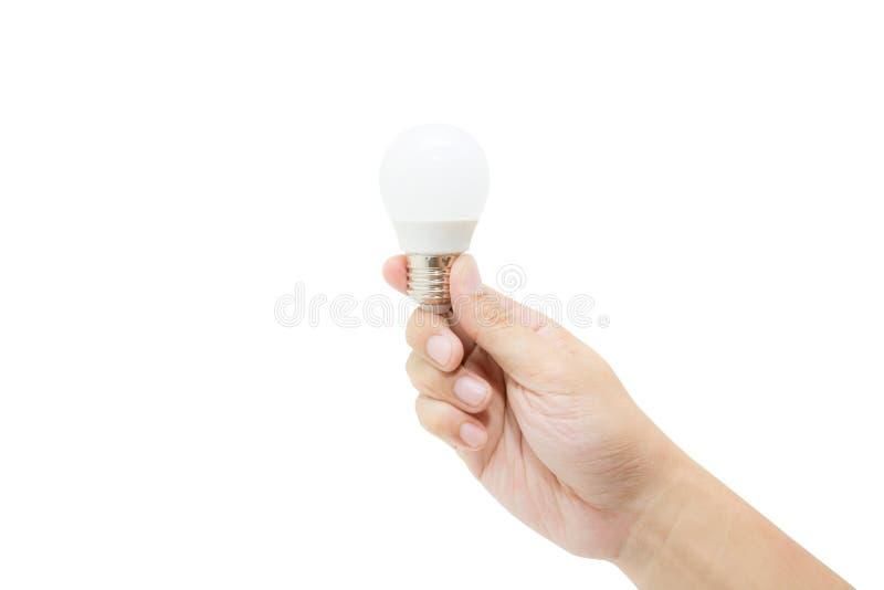 Man hand holding LED light bulb isolated on white background. royalty free stock photography