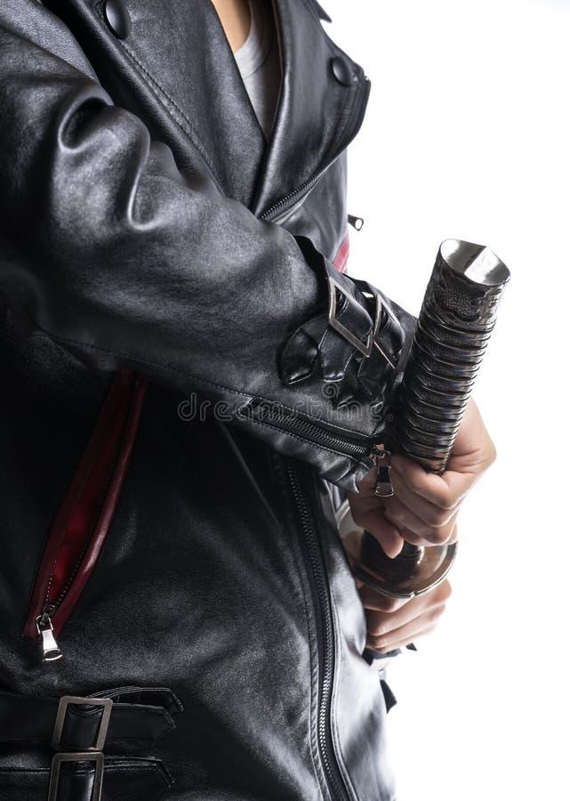Man hand holding samurai sword on white background, Leather jack. Et royalty free stock photos
