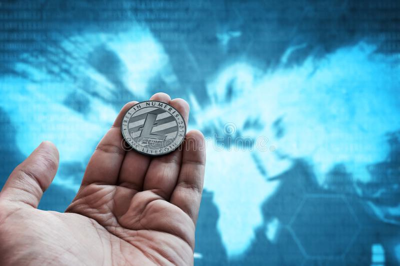 Man hand holding silver litecoin. Man hand hold silver litecoin stock photo