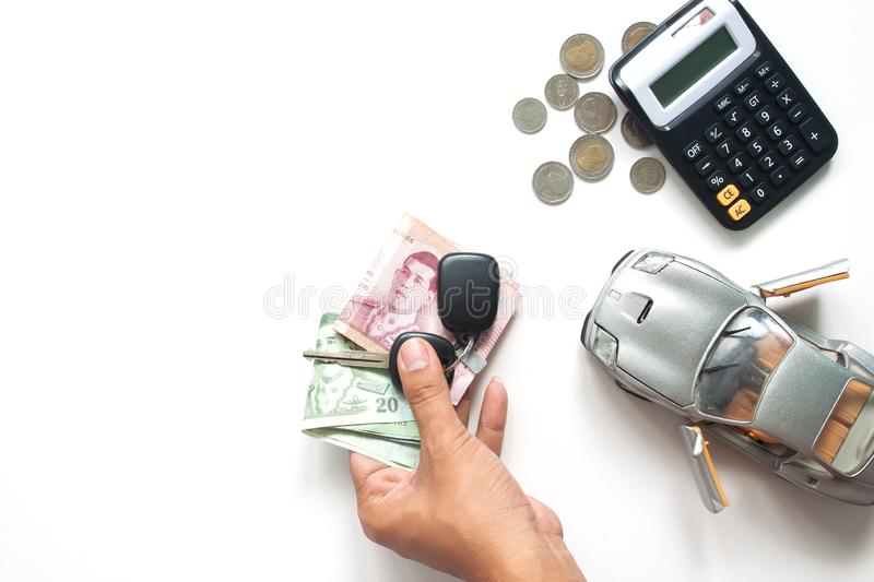 Man hand holding Thai banknotes and car key, Car loan or car fin. Ance concept royalty free stock image