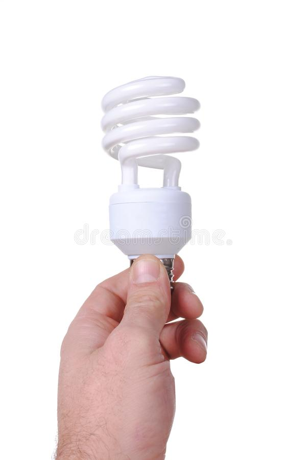 Man hand holds an energy saver bulb stock photo