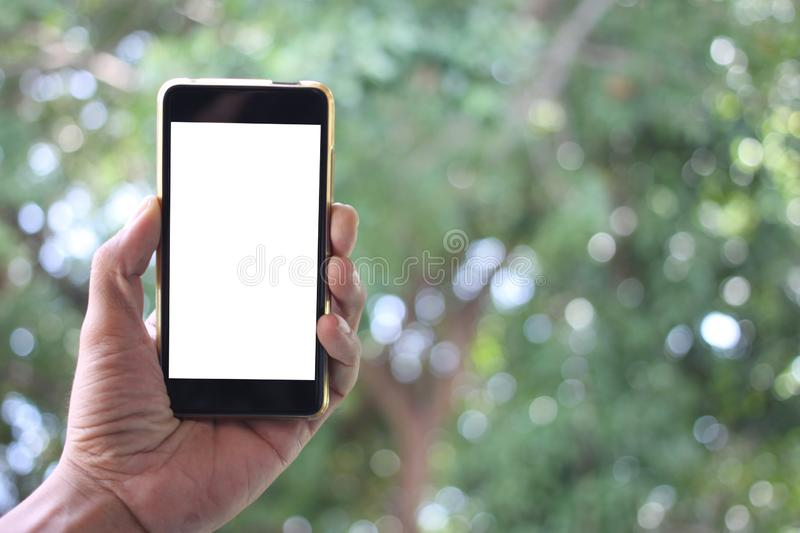 The man hand holds the smartphon blank white screen and have cop. Y space the concept in your work royalty free stock image