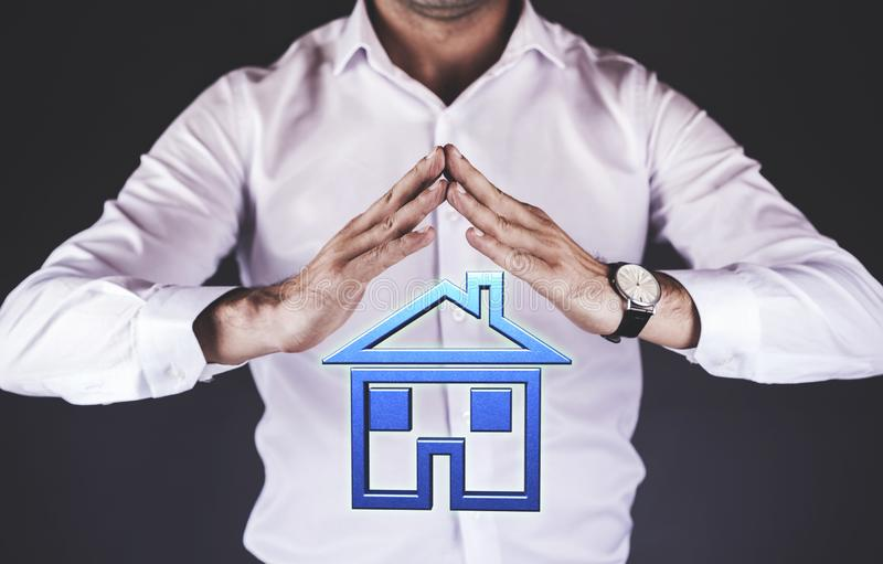 Man hand house model. Business man hand house model in screen stock images