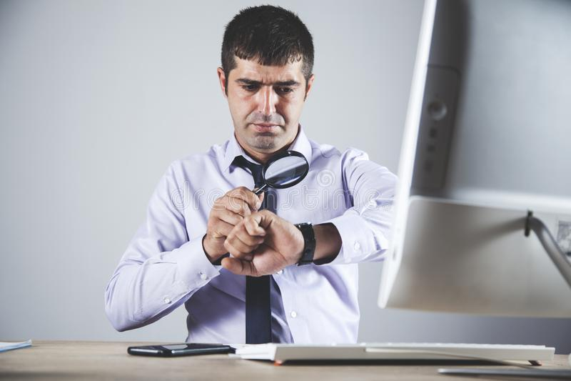 Man hand magnifier with watch stock photos