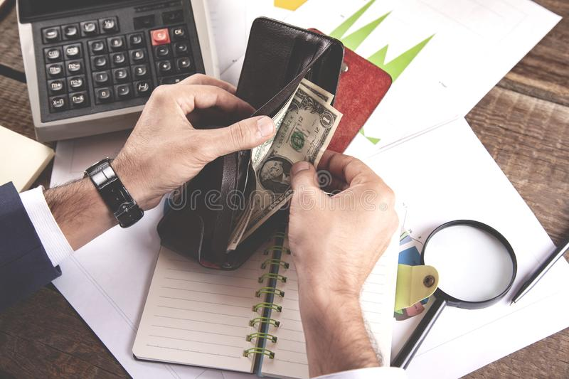 Man hand money with wallet and calculator stock photos