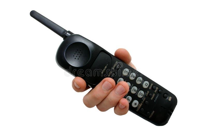 Download Man Hand Op Zwarte Draadloze Telefoon Stock Afbeelding - Afbeelding: 46717