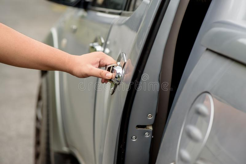 Man hand opening a car door royalty free stock photography