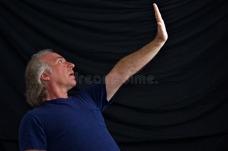 Download Man with hand out to stop stock photo. Image of blue - 21371712