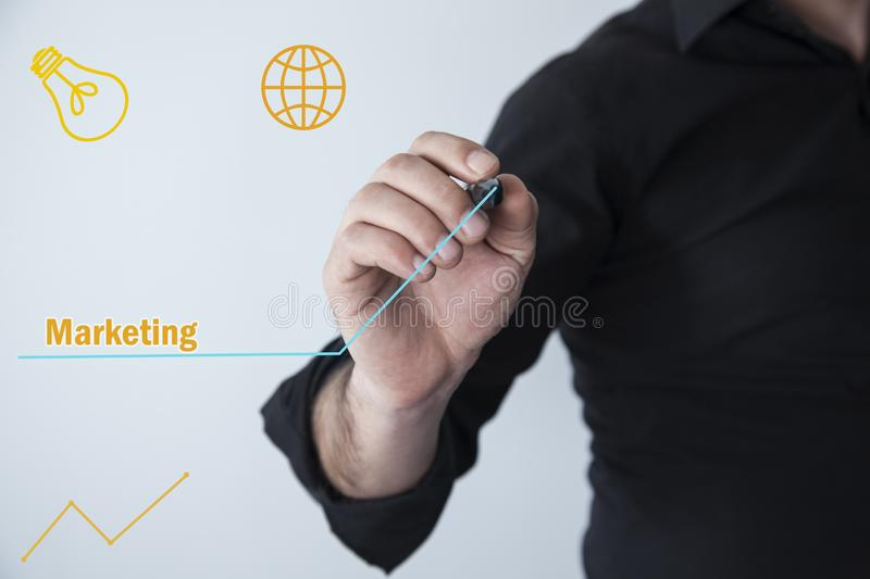 Man hand pen with marketing text. In screen royalty free stock images