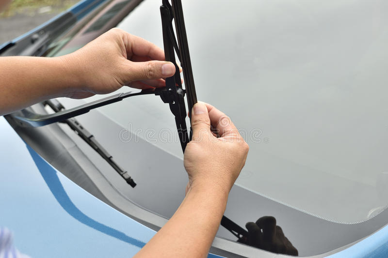 Man hand picking up windscreen wiper royalty free stock images