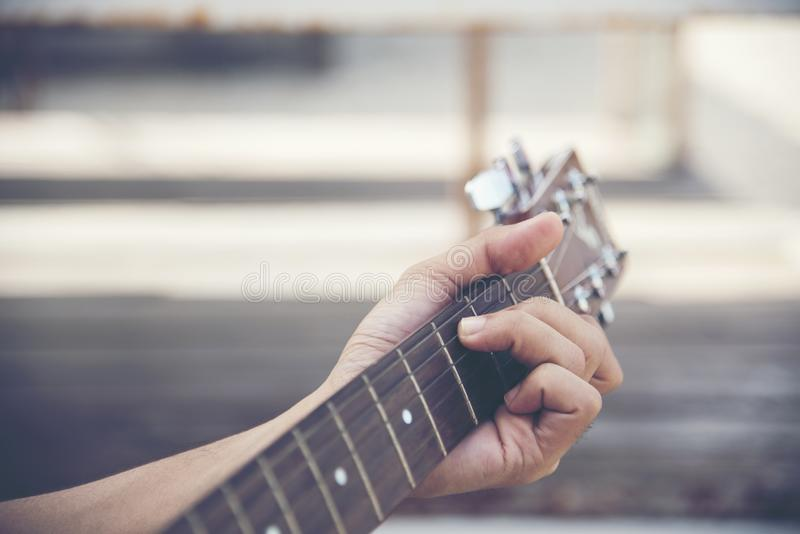 Man hand playing guitar close up hand playing c chords stock image