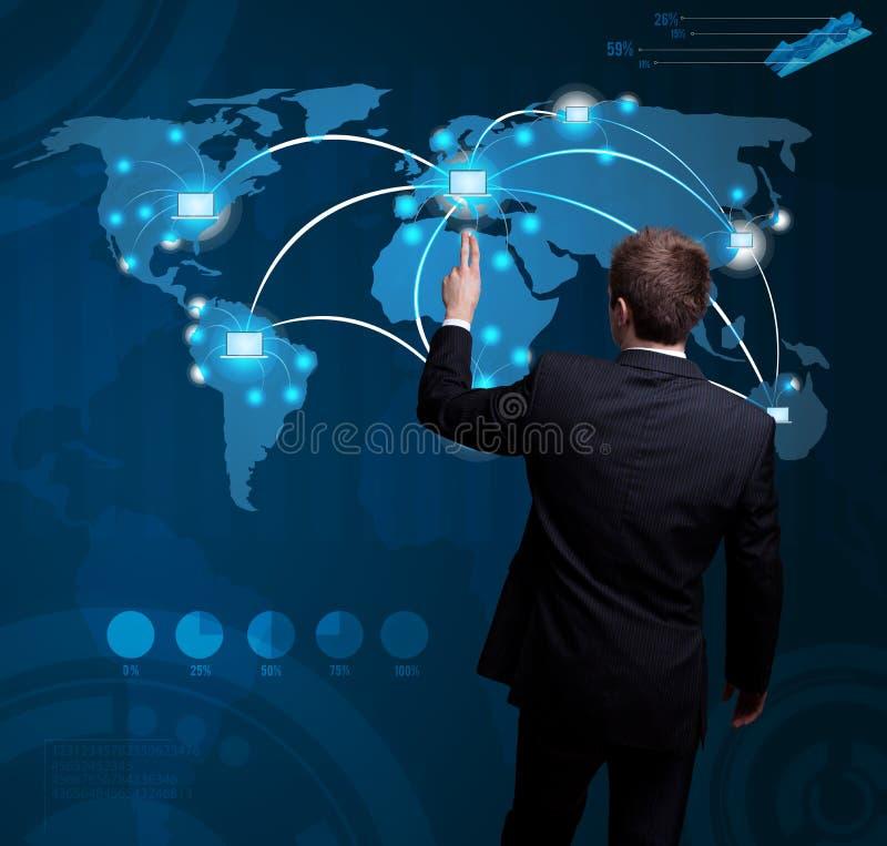 Man hand pressing digital button on futuristic map. Businessman hand pressing digital button on futuristic map