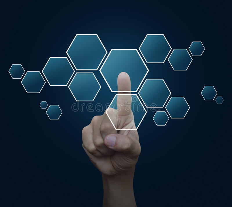 Man hand pushing blank modern virtual technology screen icon over blue background royalty free stock photo