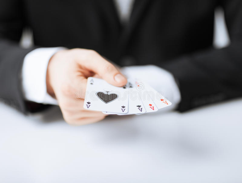 Man hand showing four aces stock image
