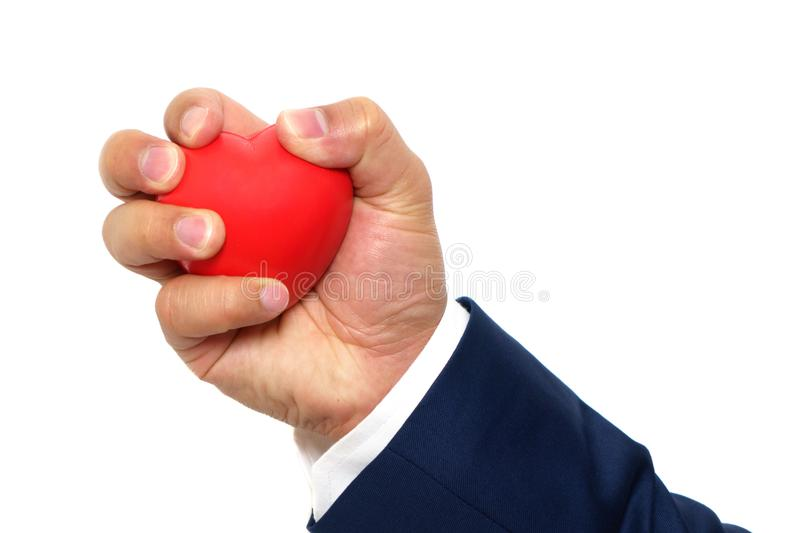 A man hand squeezing a stress ball royalty free stock photo