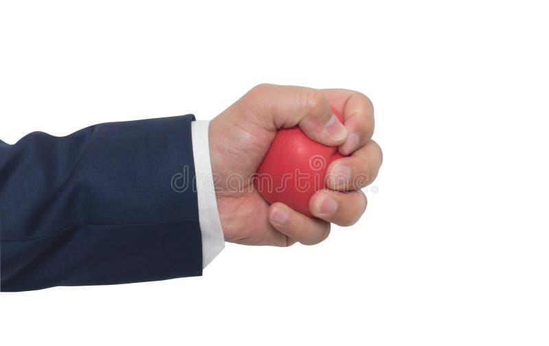 A man hand squeezing a stress ball stock photos