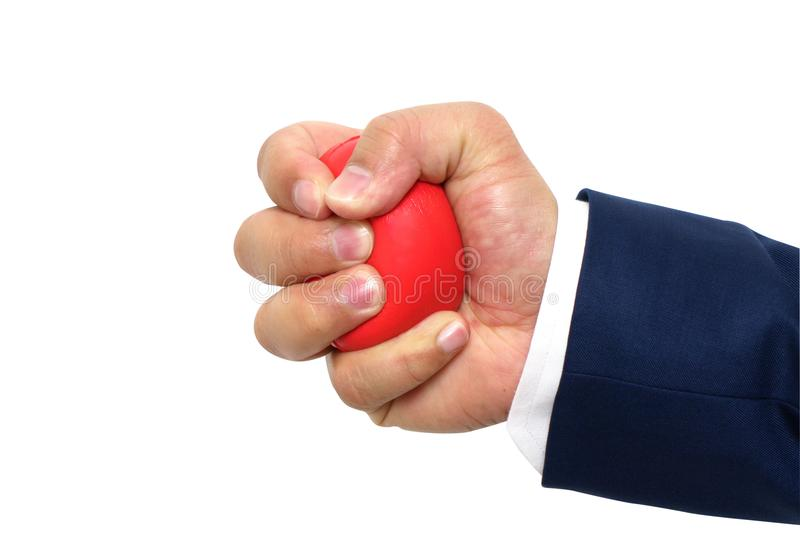 A man hand squeezing a stress ball royalty free stock photography