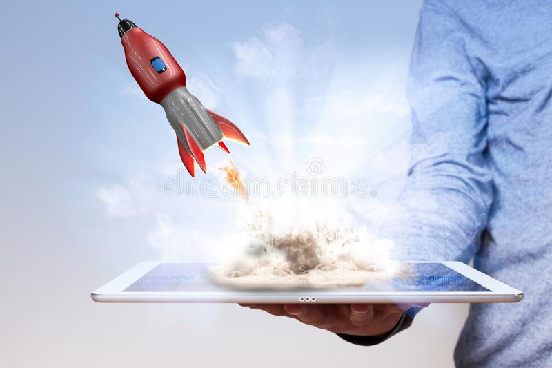 Man Hand Tablet PC Rocket royalty free stock images