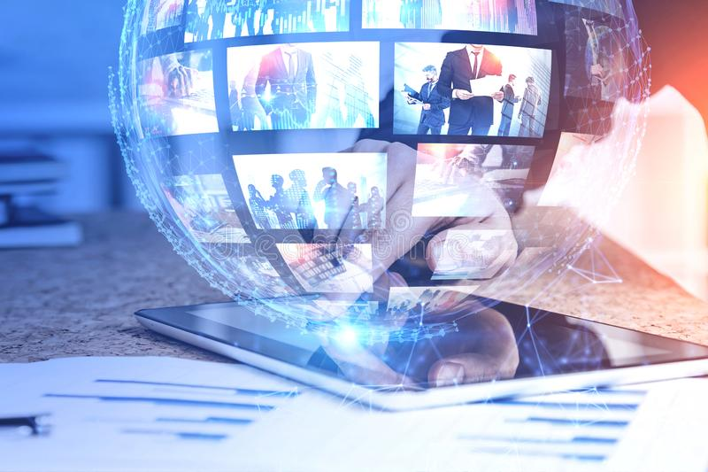 Man hand with tablet, video streaming. Hand of man using tablet with futuristic video streaming interface. Concept of internet and social media. Toned image royalty free stock image