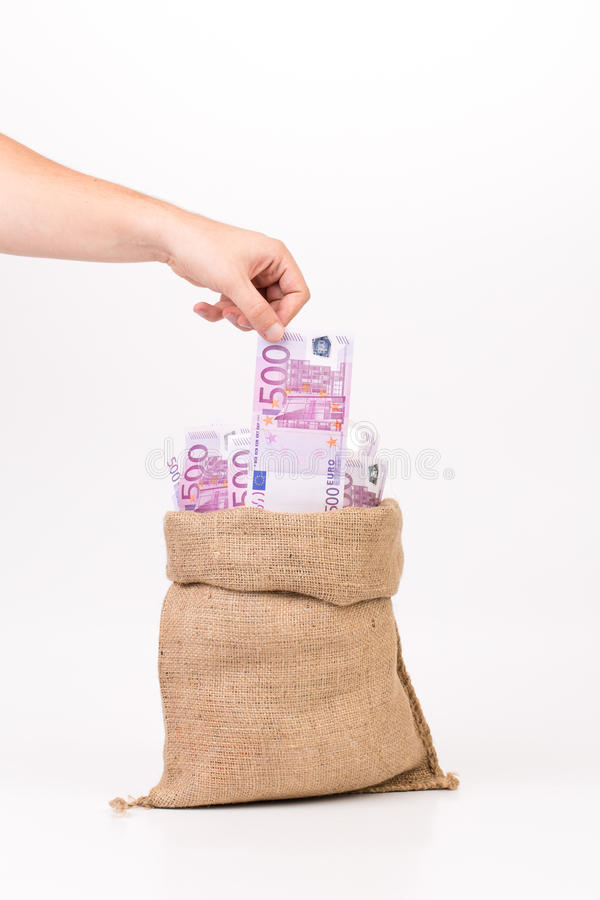 Man hand taking money euro bill from bag. royalty free stock photos