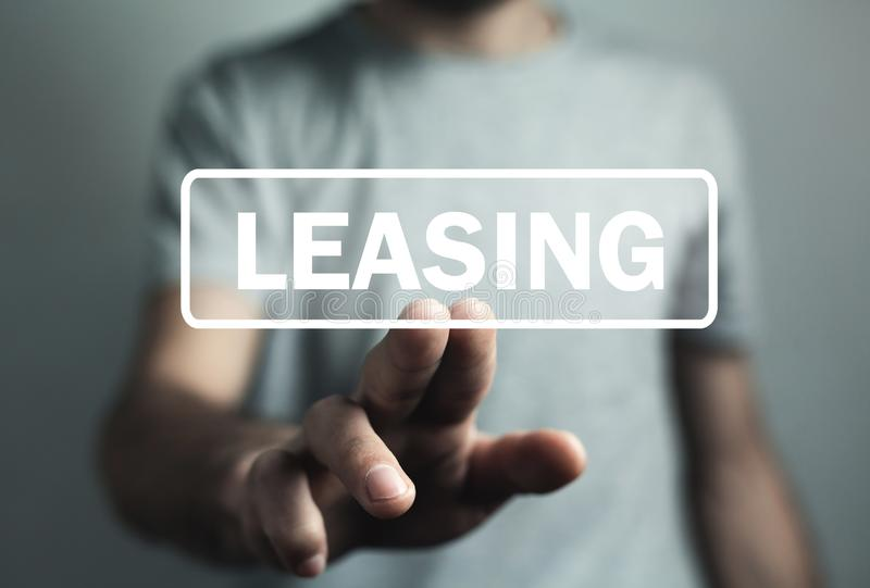 Man hand touch in Leasing text. Business stock photos