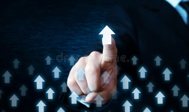 Man hand touching arrows. Business growth and success concept. stock photo