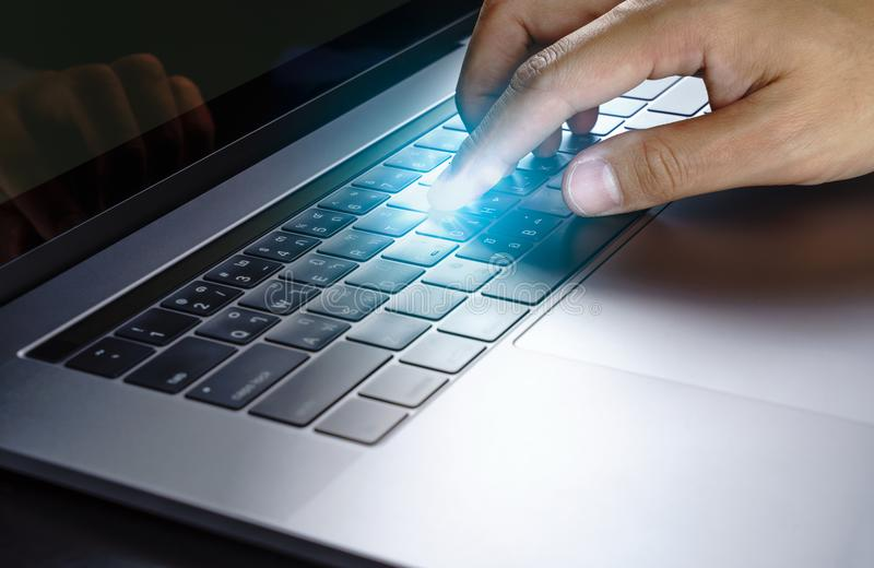 Man hand touching on laptop computer .Social media ,technology, stock photography