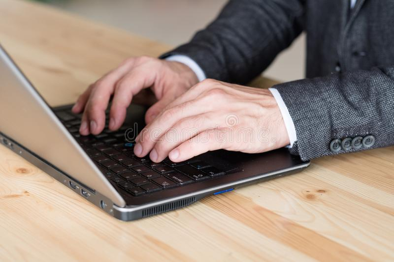 Man hand typing laptop remote job online business stock photos