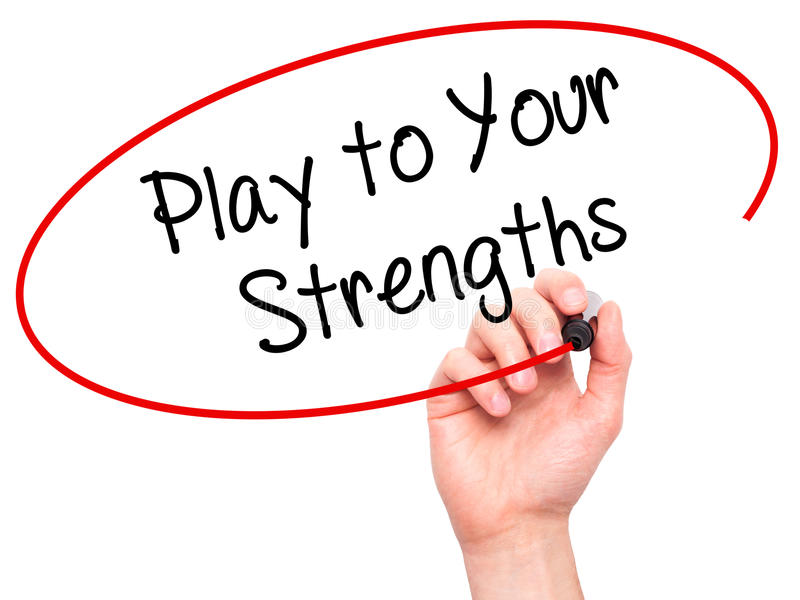 Man Hand writing Play to Your Strengths with black marker on visual screen. stock photography