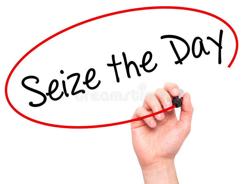 Man Hand writing Seize the Day with black marker on visual scree stock photo