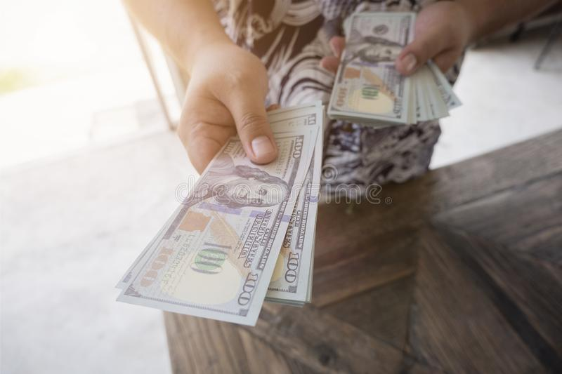 Man handed dollar bills to you, American money in hand, Cash in hands, Income and Business concept royalty free stock photos