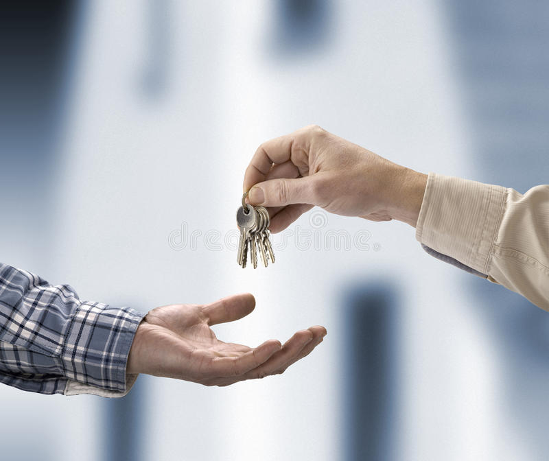 Man Is Handing A House Key Royalty Free Stock Photos