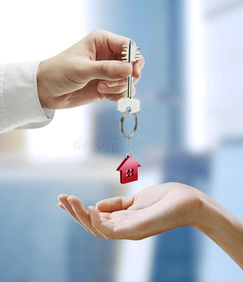 Download Man Is Handing A House Key To A Woman Stock Photo - Image: 21687694