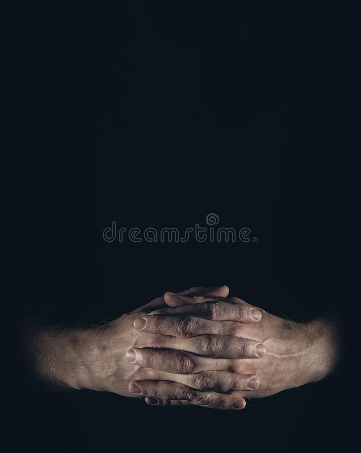 Man hands on black background stock images
