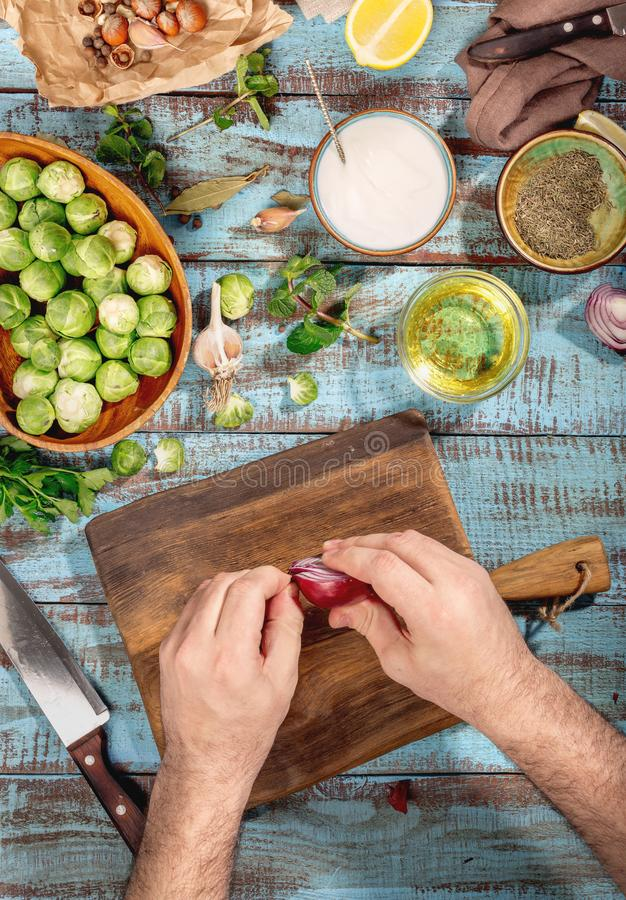Man hands cooking healthy food with brussels sprouts stock photo download man hands cooking healthy food with brussels sprouts stock photo image of nutrition forumfinder Choice Image