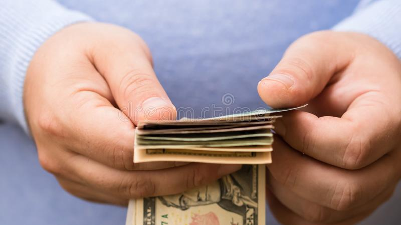 Man hands counting money, counting US dollars currency, close up stock image