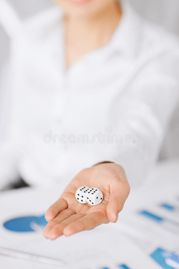 Man hands with gambling dices signing contract stock photo