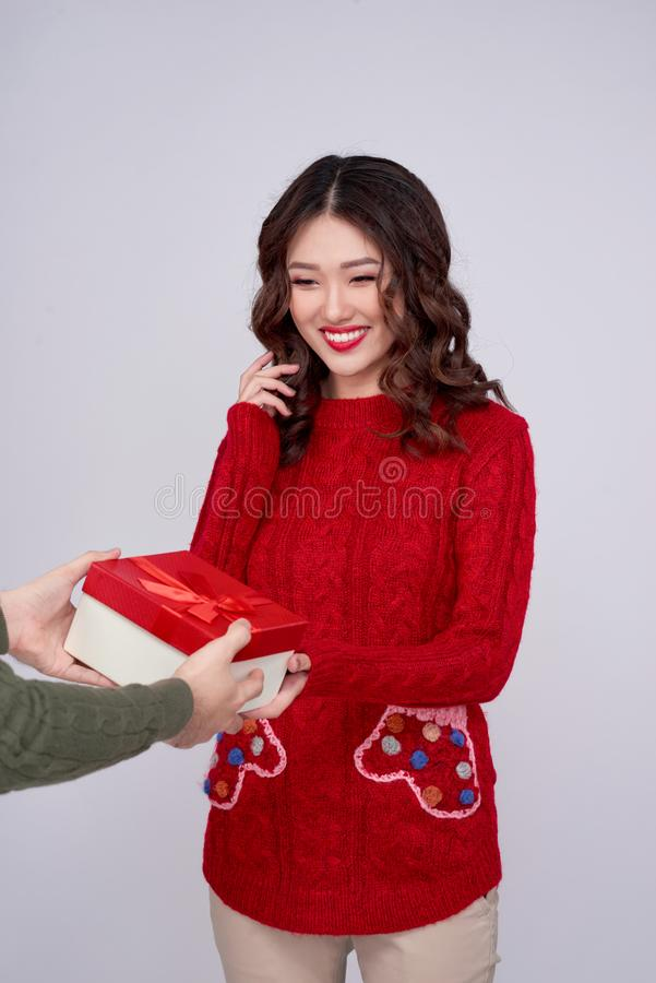 Man hands giving her girlfriend/wife a gift at home celebrating New Year royalty free stock images