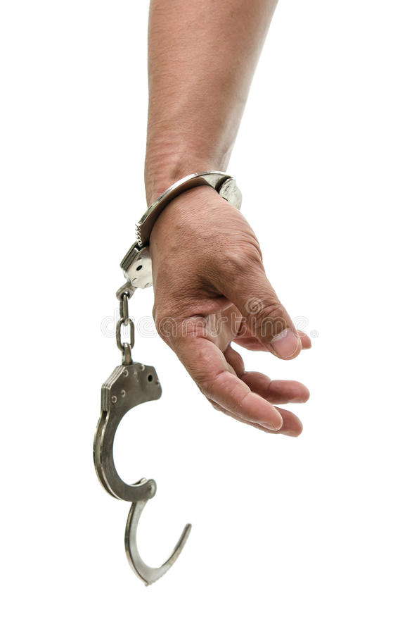 Man hands with handcuffs showing victory sign stock images